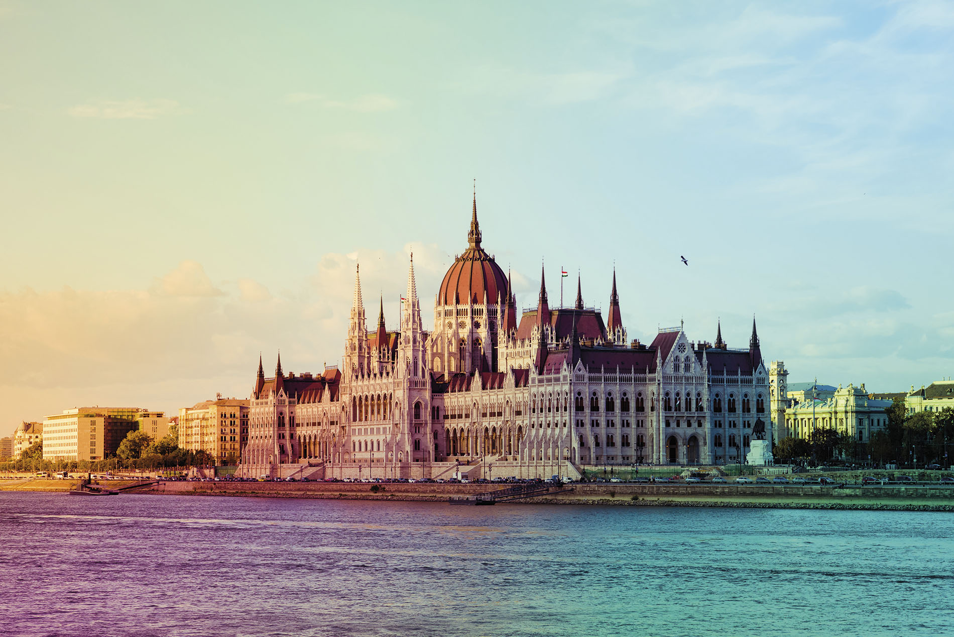 a large body of water with Hungarian Parliament Building in the background