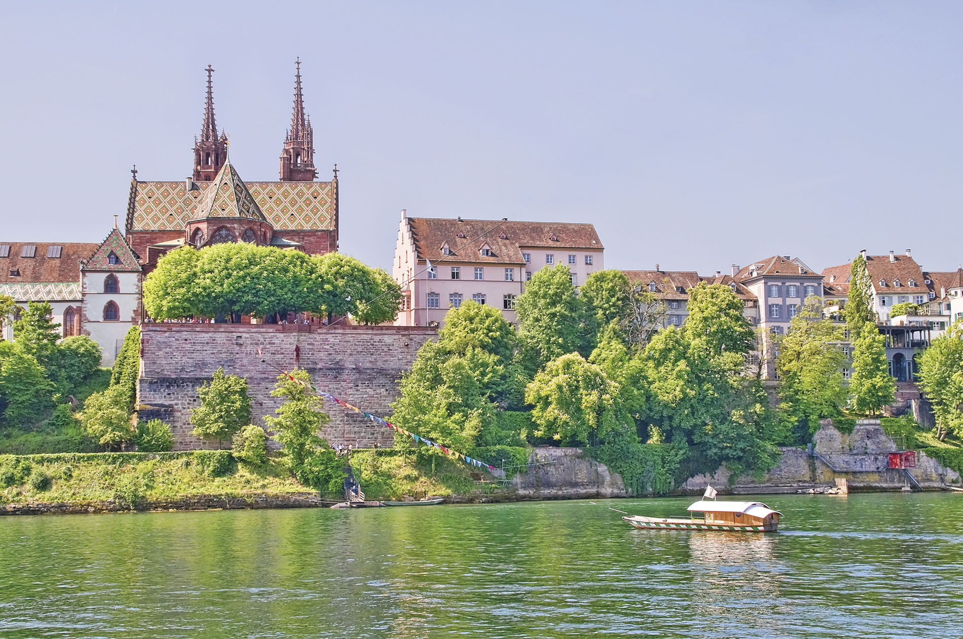 Traditional gothic architecture on serene riverside in Basel, Switzerland