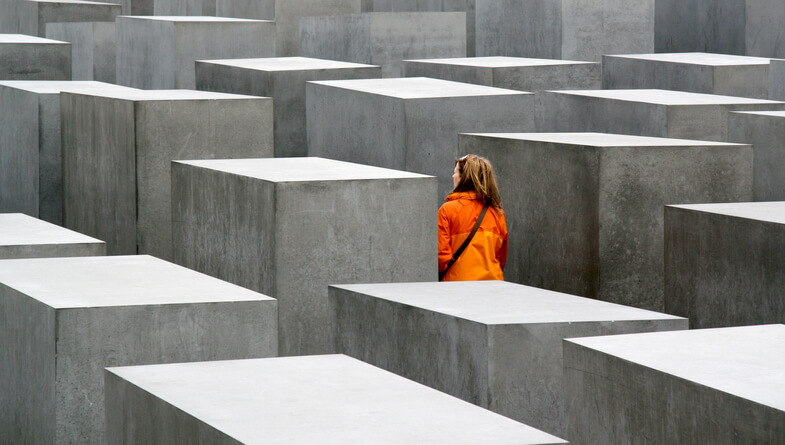 A woman observing the Memorial to the Murdered Jews of Europe monument