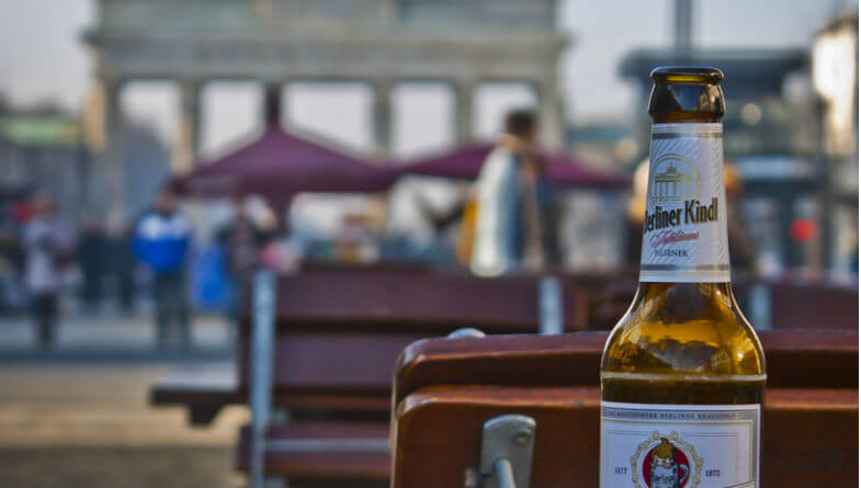 A bottle of Berliner Kindl Weisse with the Brandenburg Gate pictured in the background